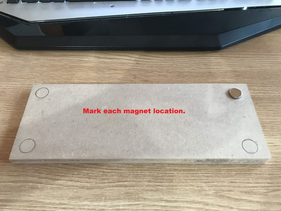 Mark the position of the magnets